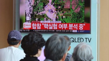People in Seoul watch a TV news report about a possible nuclear test conducted by North Korea.