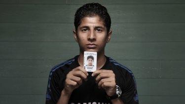 Loghman Sawari with his identify card in 2015.