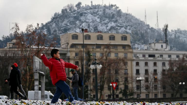 Record cold temperatures and an unusual snowfall hit Chile's capital Saturday. Normal temperatures are expected to return midweek.