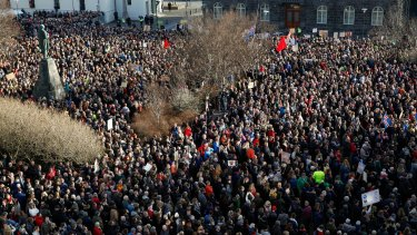 Thousands of people demonstrate against Iceland's prime minister, in Reykjavik on Monday.