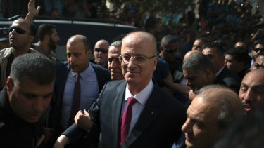 Palestinian PM Rami al-Hamdallah is surrounded by security during his visit to Gaza City.
