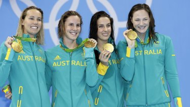 Australia's 4x100m freestyle relay team show off the gold medals they won on the first night in Rio.