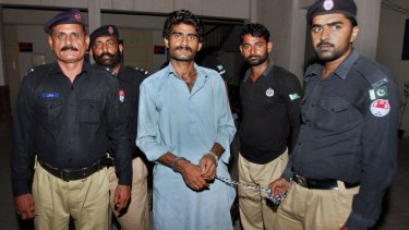 Pakistani police officers present Waseem Azeem, the brother of slain model Qandeel Baloch, before the media following his arrest at a police station in Multan, Pakistan.