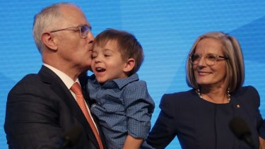 Prime Minister Malcolm Turnbull with his grandson Jack and wife Lucy at the party launch in Homebush, Sydney.