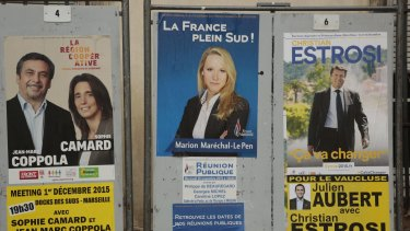 Posters for the regional elections on display at a polling station last weekend.