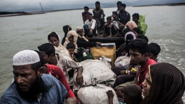 Rohingya refugees arrive by boat from Myanmar, near Teknaf, Bangladesh, in September.