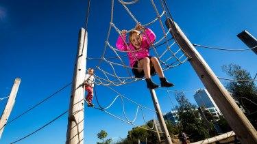 Anna, 6, hangs around at the playground.