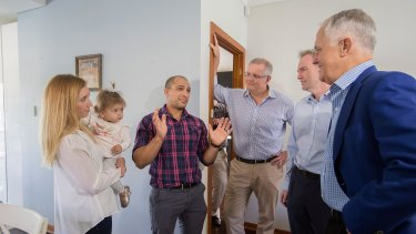 Kim and Julian Mignacca and 11-month-old daughter Addison talk to Malcolm Turnbull, Scott Morrison and local MP David Coleman about their home in Penshurst, Sydney.