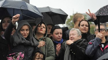 A woman carries a hanger to protest against criminalisation of abortion at Castle Square, Warsaw, on Black Monday.