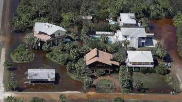 In this aerial photo, streets are flooded near homes in Flagler Beach, Florida.