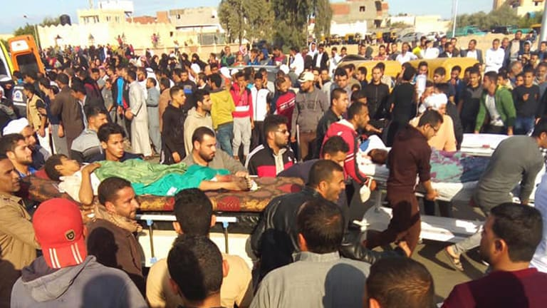 Injured people are evacuated from the scene of a militant attack on a mosque in Bir al-Abd in the northern Sinai Peninsula on Friday.