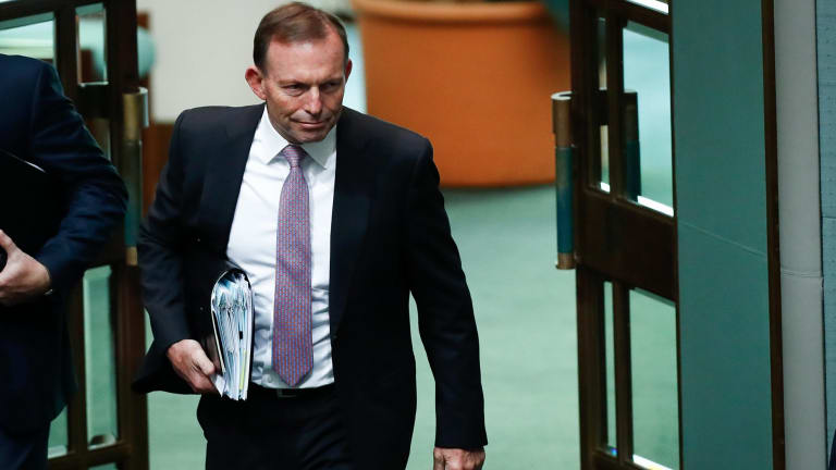 Former prime minister Tony Abbott arrives for Question Time at Parliament House in Canberra.