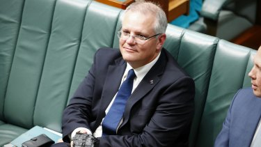 Treasurer Scott Morrison with a lump of coal during question time.