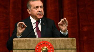 President Recep Tayyip Erdogan gives a speech commemorating those killed and wounded during the failed coup.