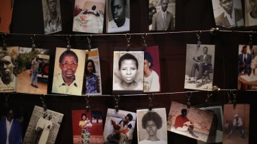 In 2014, family photos of victims of the 1994 Rwanda genocide hang inside the Kigali Genocide Memorial Centre in Kigali, Rwanda.