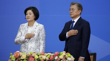 South Korea's new President Moon Jae-In and his wife Kim Jung-Suk salute during the presidential inauguration ceremony at National Assembly in Seoul on May 10.