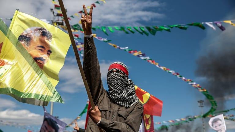 A Kurdish man holds up a picture of PKK leader Abdullah Ocalan in Diyarbakir, Turkey, in March 2015.