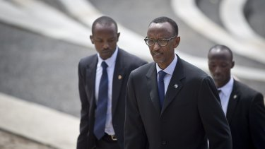 Rwanda's President Paul Kagame, centre, flanked by security personnel, in Kigali last year.