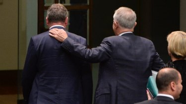 Deputy Prime Minister Barnaby Joyce and Prime Minister Malcolm Turnbull leave the chamber after the citizenship motion.