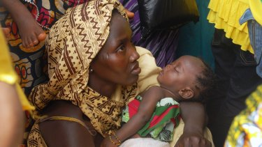 A Sierra Leonean mother attends a medical program launch in the country's capital, Freetown.