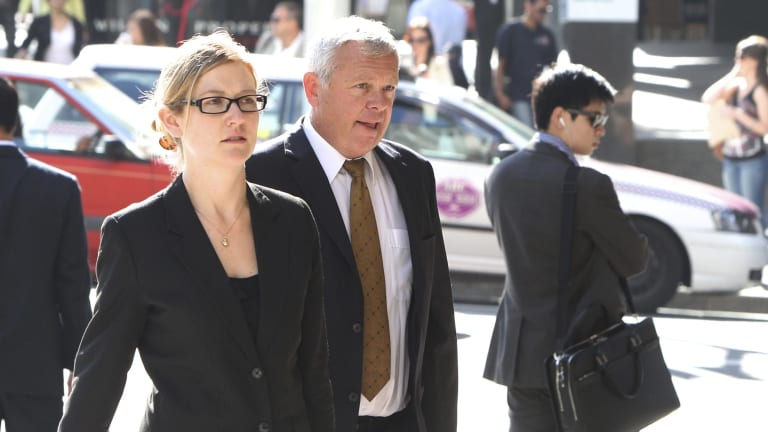 In 2012, Murray Lapham (centre) and Sam Pogson admitted  making a false or misleading statement to obtain a financial advantage for the company.