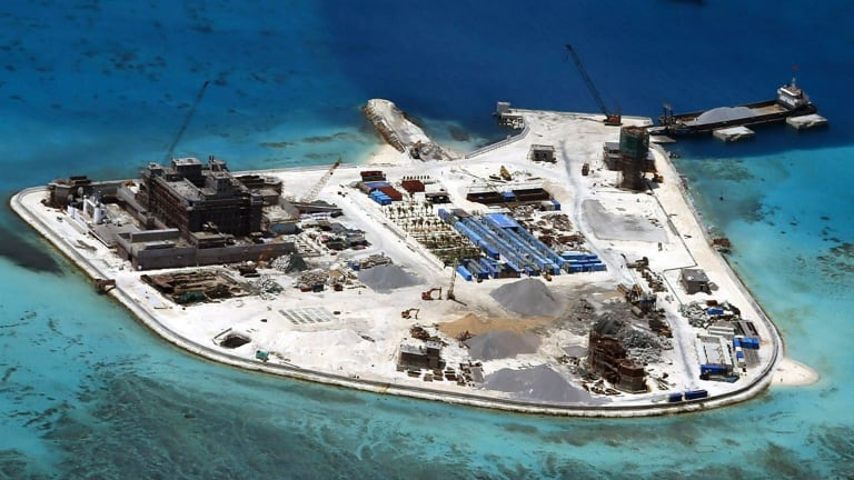 south china sea china installs weapons on artificial islands says