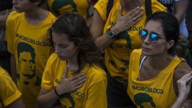 Demonstrators wearing t-shirts with the image of Brazilian Federal Judge Sergio Moro, during an anti-corruption protest in Rio de Janeiro.