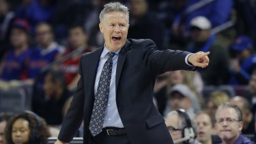 Getting his point across: Philadelphia coach Brett Brown barks instructions during a win in Detroit.