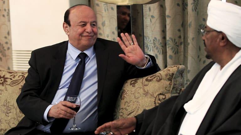 Yemeni President Abed-Rabbu Mansour Hadi drinks with Sudanese President Omar Hassan al-Bashir in Khartoum last week. Sudan is a member of the Saudi-led coalition seeking to restore Mr Hadi.