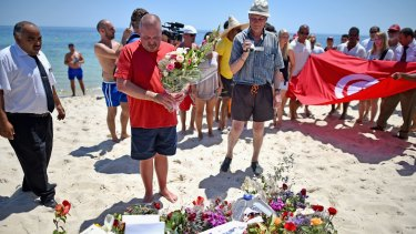 June 2015: Tourists pay tribute to 38 people killed at Marhaba beach in Sousse by a terrorist attack.
