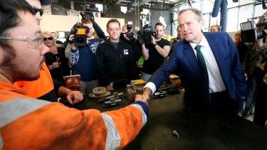 Opposition Leader Bill Shorten visits the automotive workshop during a visit to TAFE SA.