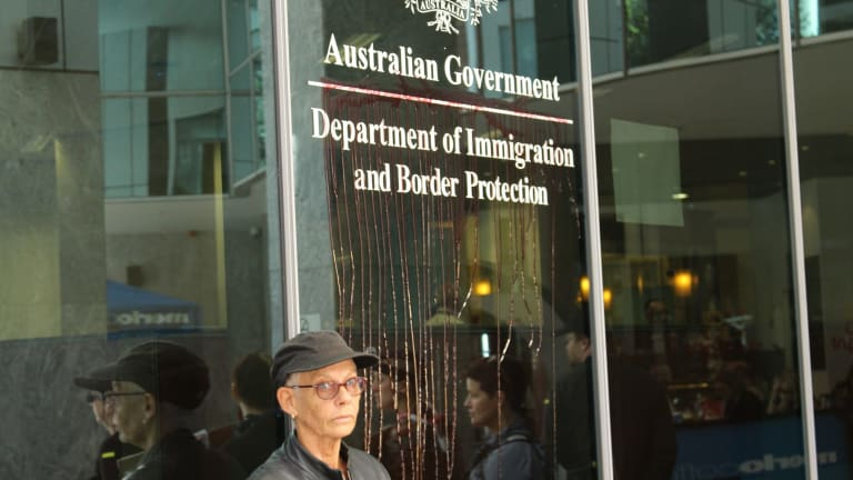 Fake blood was spattered at the Immigration Department building in Brisbane.