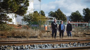 Project manager Ewen McKenzie, Dean Ward from ActewAGL, and Director of Capital Recycling Solutions Adam Perry at the former Shell site marked for development as a waste recycling facility. Photo: Sitthixay Ditthavong