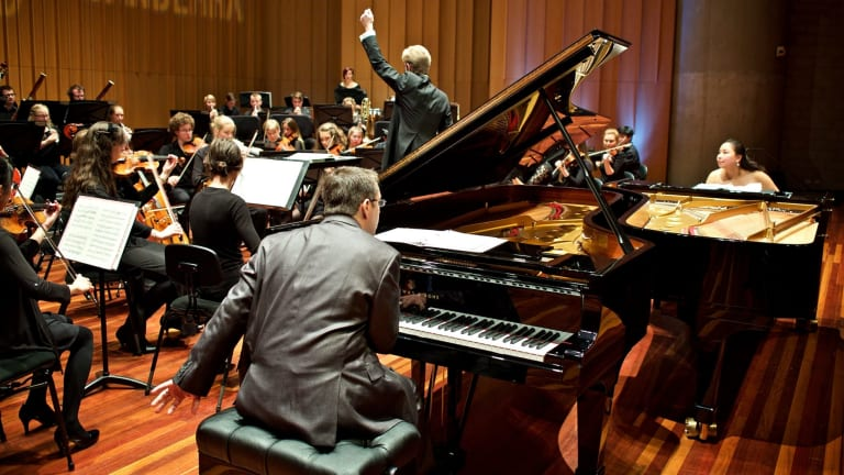Pianists Dr Edward Neeman and Dr Stefanie Neeman and the Canberra Youth Orchestra conducted by Leonard Weiss.