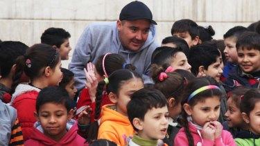Luke Cornish in Syria where he has been using street art to help children.