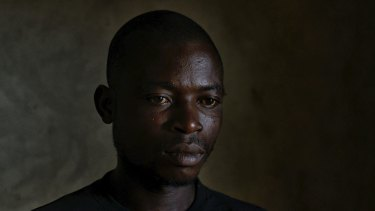 William Togpah, who helped burn bodies during the Ebola outbreak, in Marshall, Liberia.