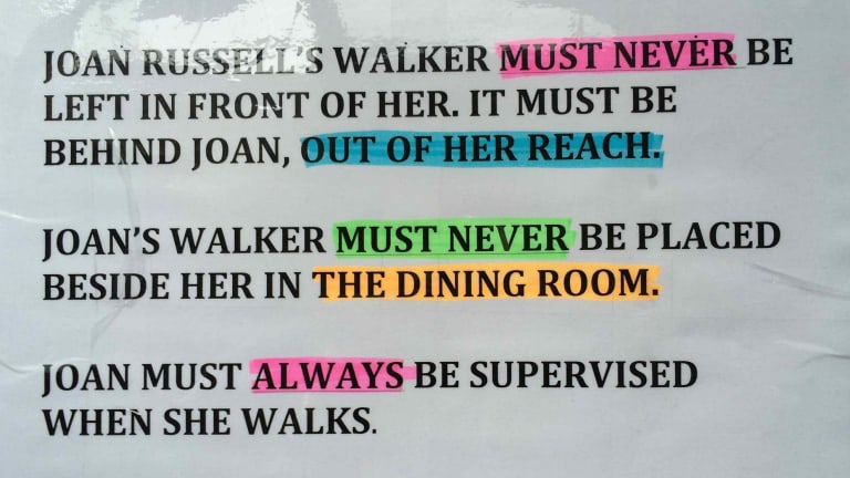 The note Sarah Russell put on her mother's walker in an aged care facility. Despite the note, Joan had a fall when the walker was placed beside her, and died six weeks later.