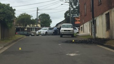 The getaway car used in the shooting at Mortlake on Friday morning was found burnt out in an industrial area in Belmore in Sydney's south-west.