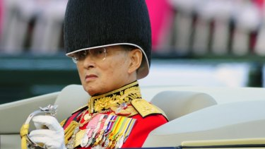 Insulted: Thai King Bhumibol Adulyadej, in a military parade in Bangkok in 2007.