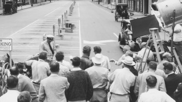 While part of Lonsdale Street was blocked off to appear desolate, crowds gathered to get a glimpse of Gregory Peck.