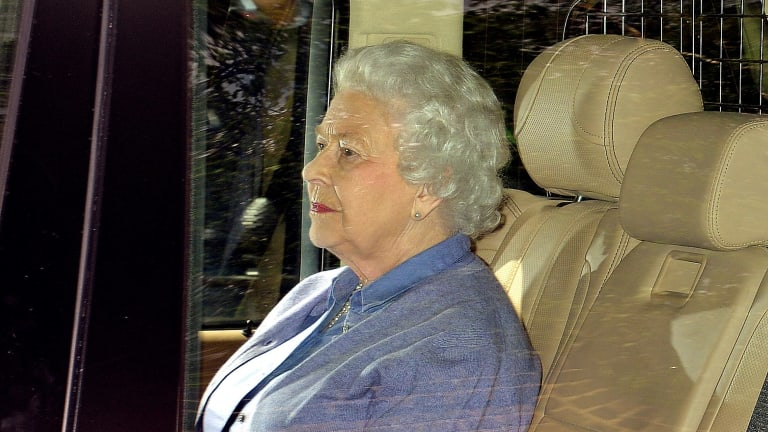 Proud great grandmother ... Britain's Queen Elizabeth II sits in the back seat of her vehicle after meeting her great granddaughter Princess Charlotte.