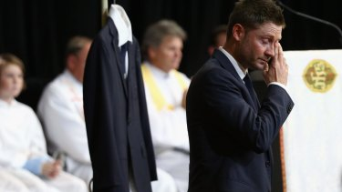 'I keep looking for him, I know it's crazy': Michael Clarke fights through tears as he speaks at the service.