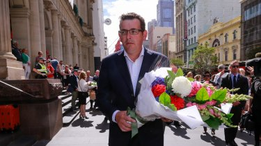 Premier Daniel Andrews lays flowers in the Bourke Street Mall.