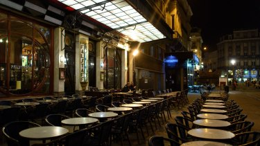 Empty tables outside a restaurant on Rue Henri Maus in Brussels on Monday.