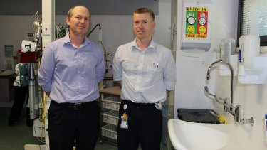 Associate Professor Sebastiaan van Hal (left) and Simon Burke, nursing unit manager of Royal Prince Alfred's Neonatal Intensive Care Unit, next to one of the sinks that was redesigned following an outbreak of a superbug.