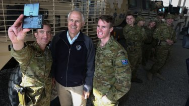 Prime Minister Malcolm Turnbull poses for selfies with ADF trainers and force protection troops at the Afghanistan National Army Officer Academy in Kabul in January.