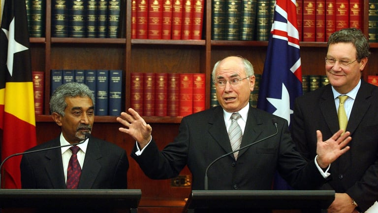 """East Timor's then prime Minister Mari Alkatiri with John Howard and Alexander Downer in 2006 after signing a """"Treaty on Certain Maritime Arrangements in the Timor Sea""""."""
