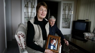 Karen and Stephen Breckenridge with a photo of their son David.