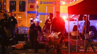 A wounded person is walked in on a wheelbarrow as Las Vegas police respond during an active shooter situation on the Las Vegas Strip.