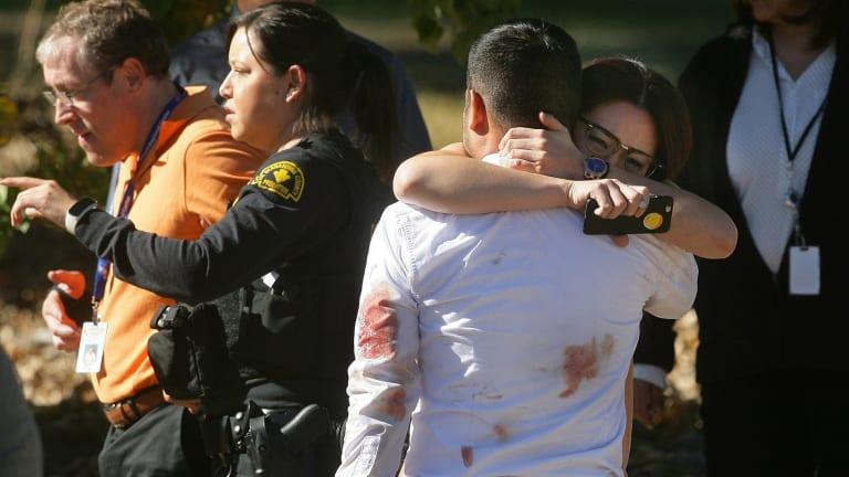 A couple embrace following the San Bernardino shooting in early December.